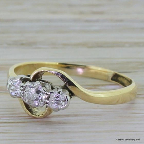 Edwardian 0.30 Carat Old Cut Diamond Trilogy Crossover Ring, circa 1910