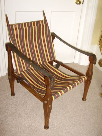 OAK CAMPAIGN OR SAFARI CHAIR BEING DISMANTABLE & RECENTLY REUPHOLSTERED C1910.