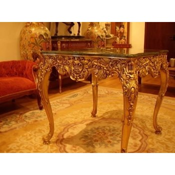 CARVED GILT GAMES TABLE WITH GREEN MARBLE MOUNTED TOP.