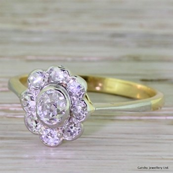 Edwardian 0.90 Carat Old Mine Cut Diamond Cluster Ring, circa 1910