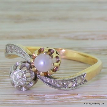 Edwardian 0.17 Carat Old Mine Cut Diamond & Pearl Crossover Engagement Ring, circa 1910