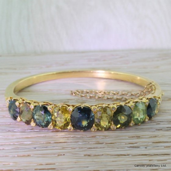 Victorian 14.50 Carat Multi Colour Sapphire Hinged Bangle, circa 1850