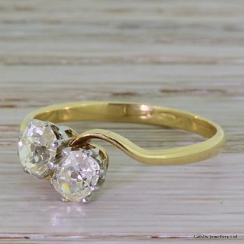 Edwardian 1.10 Carat Old Oval Cut Diamond Crossover Ring, circa 1910
