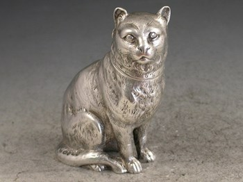 Victorian Novelty Cast Silver Pepper formed as a seated collared Cat