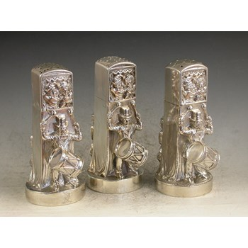 Garniture of three Victorian cast silver Pepper Pots in the form of Punch and Judy Puppet Booths